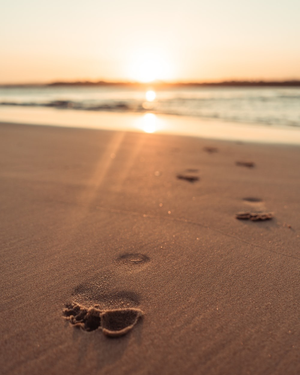 Footprints left behind on a beautiful beach travel location.