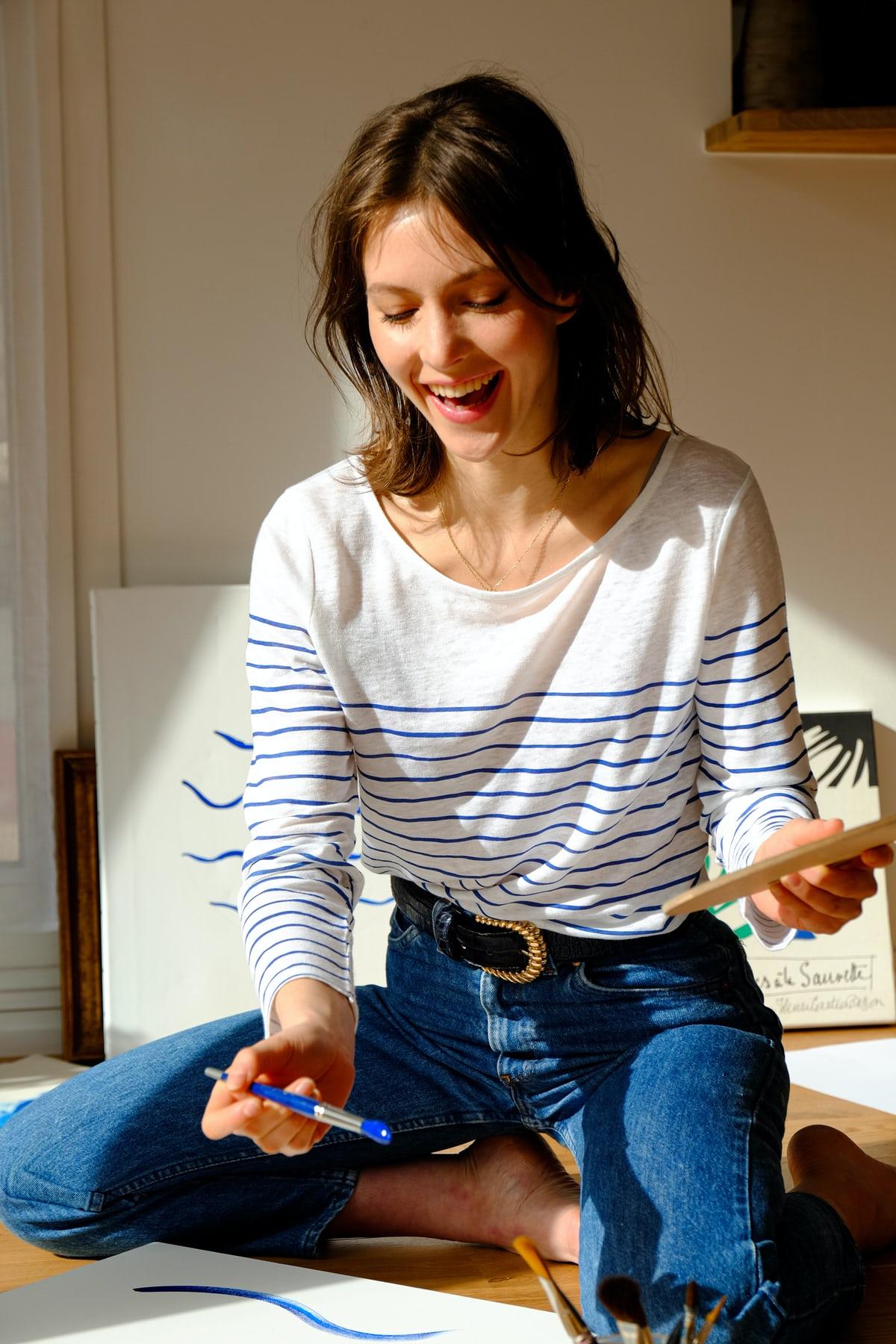 Woman having fun while painting.